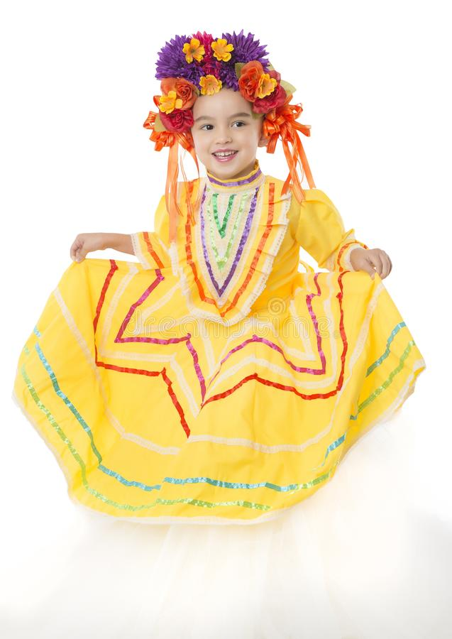 Traditional Mexican dress and hair piece. Beautiful little girl wearing colorful traditional Mexican dress and hair piece, white background stock photos