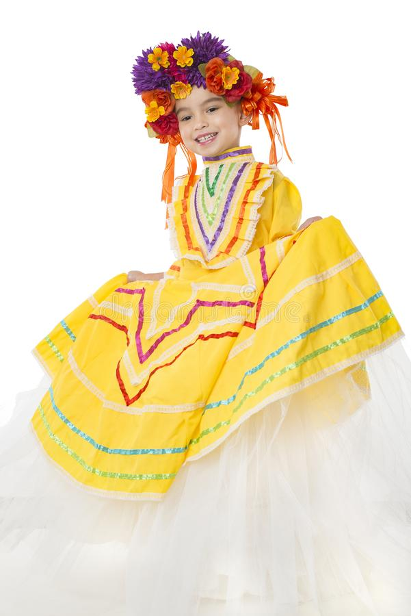 Traditional Mexican dress and hair piece. Beautiful little girl wearing colorful traditional Mexican dress and hair piece, white background stock photo
