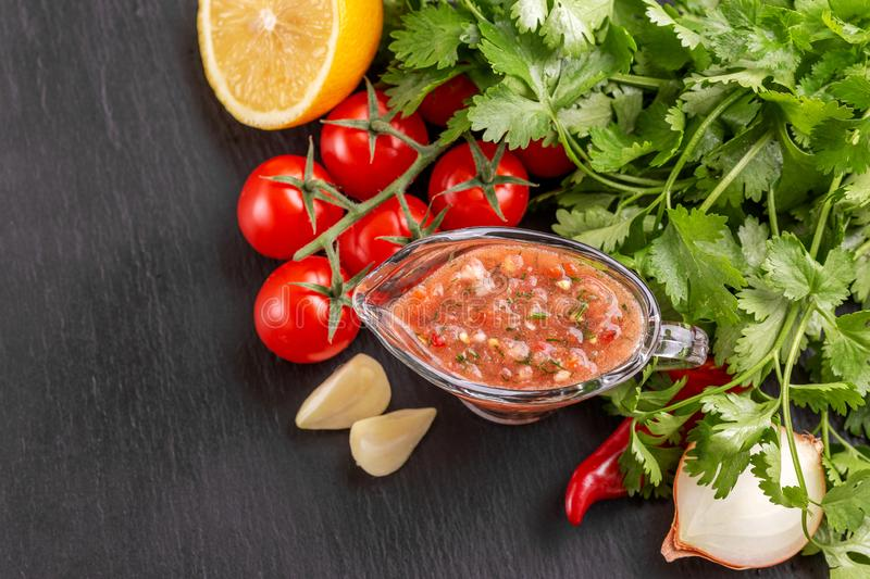 Traditional mexican red spicy sauce salsa with ingredients stock photos