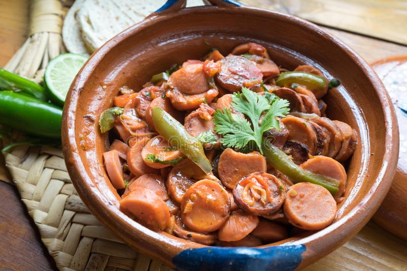 Mexican sausage stew with serrano pepper and tomato. Traditional mexican sausage stew with serrano pepper and tomato stock photos