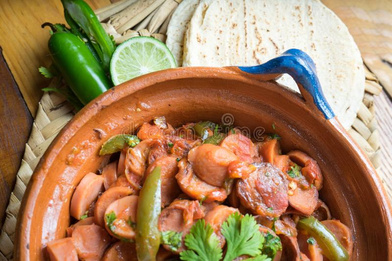 Mexican sausage stew with serrano pepper and tomato. Traditional mexican sausage stew with serrano pepper and tomato royalty free stock photos