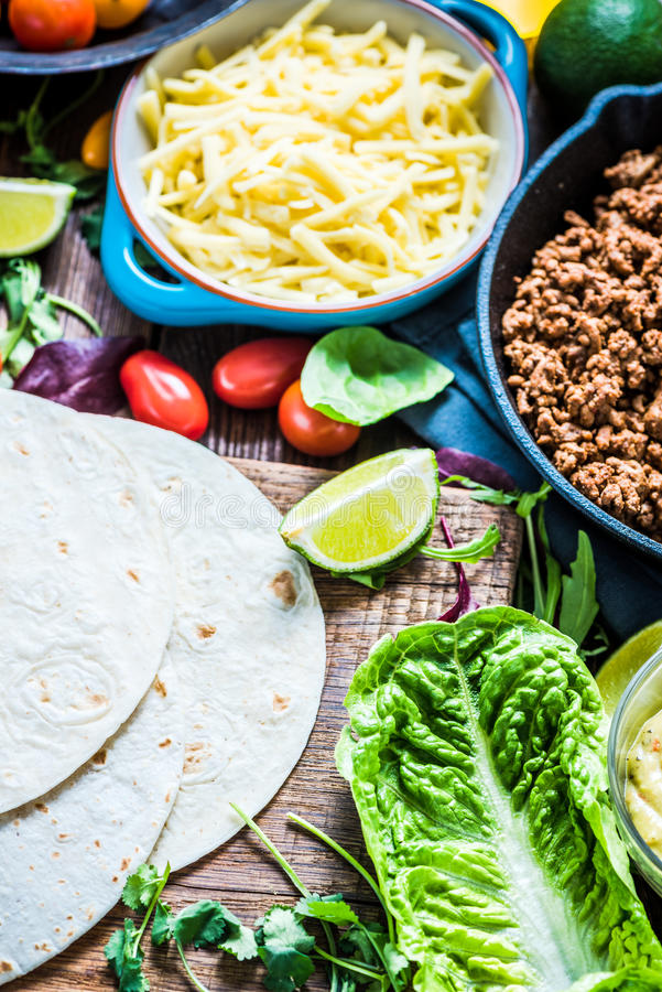 Traditional mexican tortillas or fajita recipe. Traditional mexican tortillas or fajita recipe with ingredients on wooden table from overhead royalty free stock photography