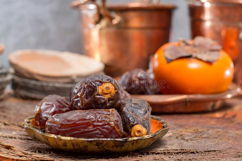 Traditional Middle East dessert, healthy food, big medjool dates. Fruits served on old wooden table stock image