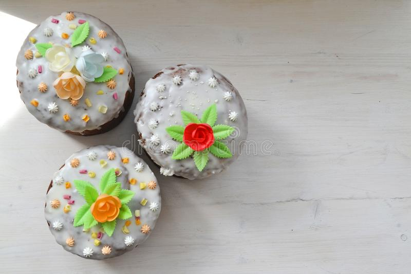 The traditional mix easter cakes on white wooden background top view with copy space royalty free stock images