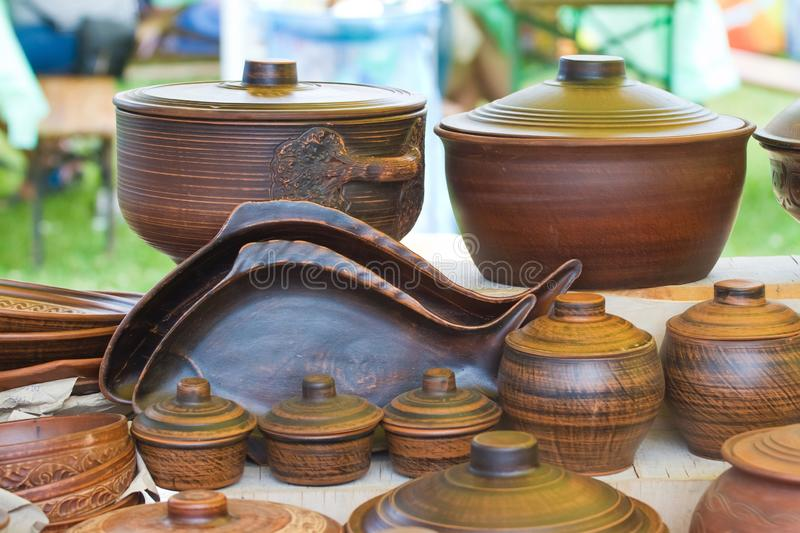 Traditional and modern style handmade ceramic clay plates, pots and pans on sale at ethno festival. Fair royalty free stock photos