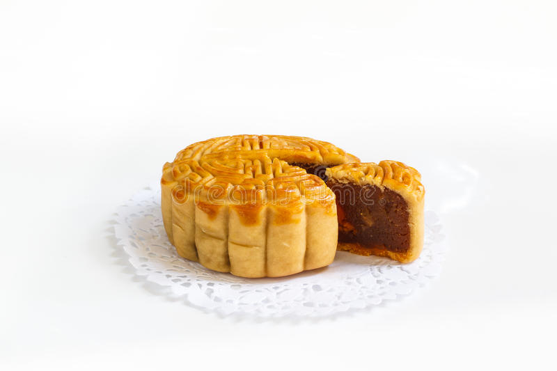 Download Traditional Mooncake With Durian And Egg Yolk Filling On Paper Doily, Stock Photo - Image: 83708358