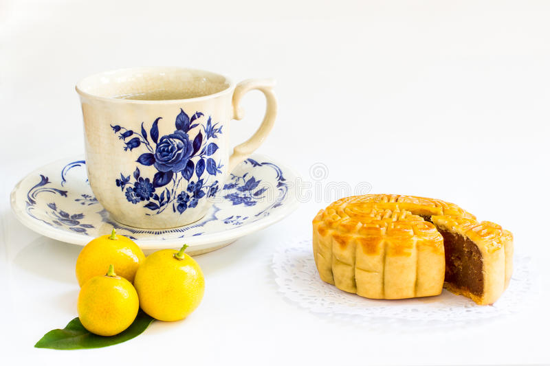 Download Traditional Mooncake With Durian And Egg Yolk Filling And Tea Cup Stock Image - Image: 83709725