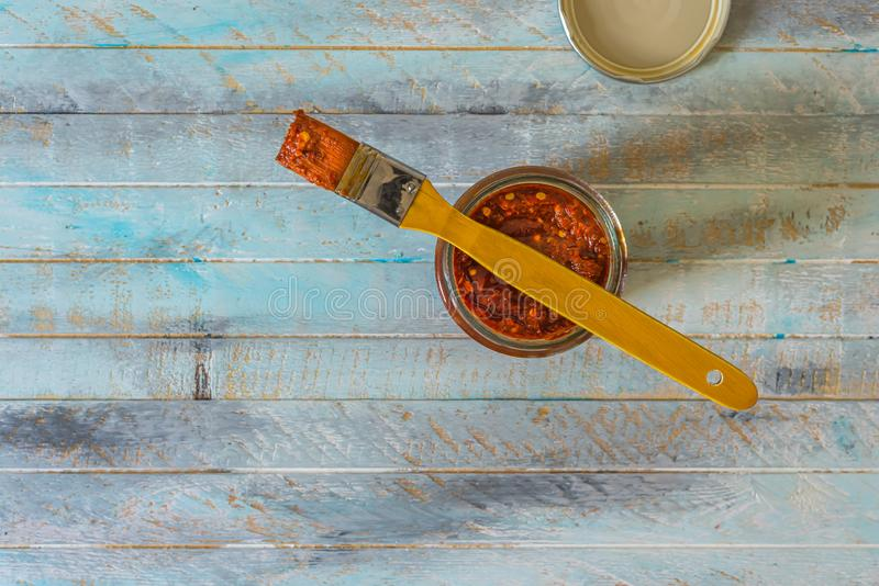 Traditional Moroccan healthy spicy harissa. Vegetarian appetizer or dip with roasted red peppers, flat lay or top view on wooden background. Homemade Tunisia royalty free stock images