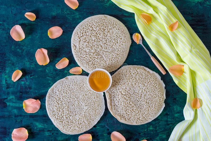 Traditional Moroccan pancakes baghrir on dark green wooden background stock images