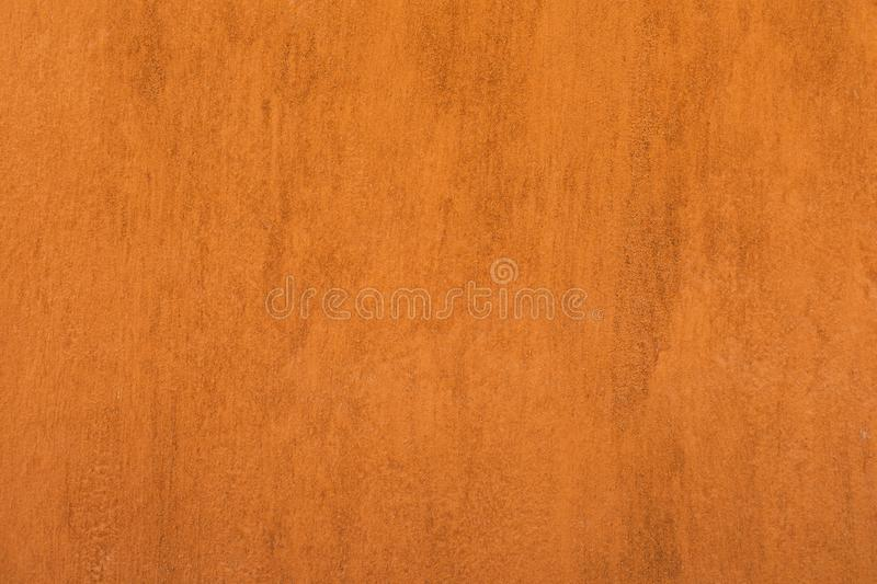 Traditional moroccan terracotta colored background. Orange or ocher clay wall texture. Painted shabby concrete stock image