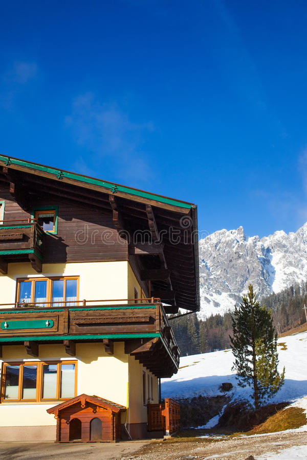 Traditional mountain chalets. On a cold sunny day with blue sky stock images