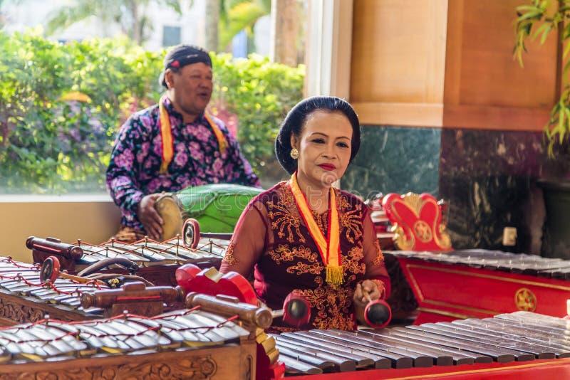 Traditional music Indonesia. Jakarta, Indonesia - November, 02, 2017 Couple playing music on tradiitonal Indonesian instruments royalty free stock image