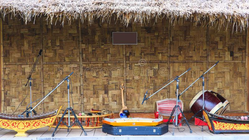 Traditional musical instruments to be displayed in front of the bamboo hut stock photos