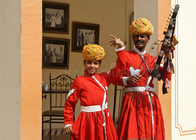 Traditional musicians of Rajasthan. Musicians - father and son - giving daily performance in a Jaipur Palace in Rajasthan, India. Jaipur belongs to the Golden royalty free stock photo