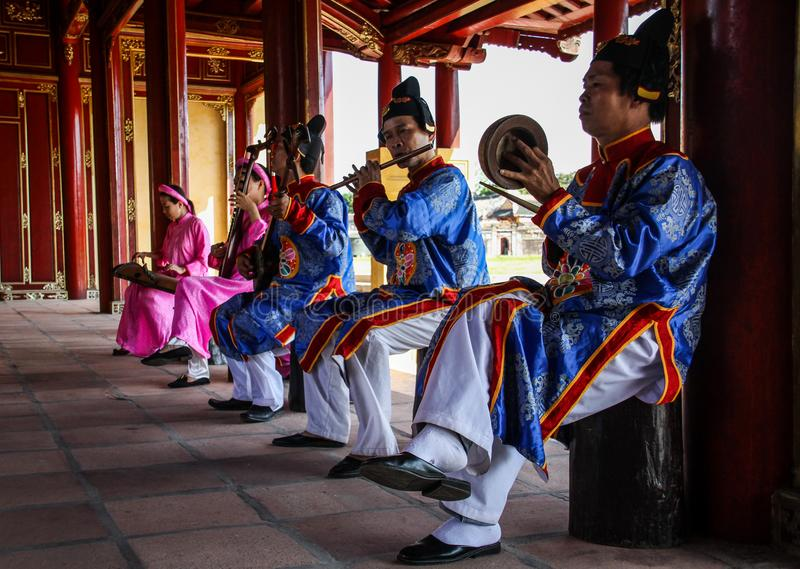 Traditional music players in the Imperial City of Hue, Thua Thien-Hue, Hue, Vietnam. The Imperial City is a walled palace within the citadel of the city of Hue royalty free stock image