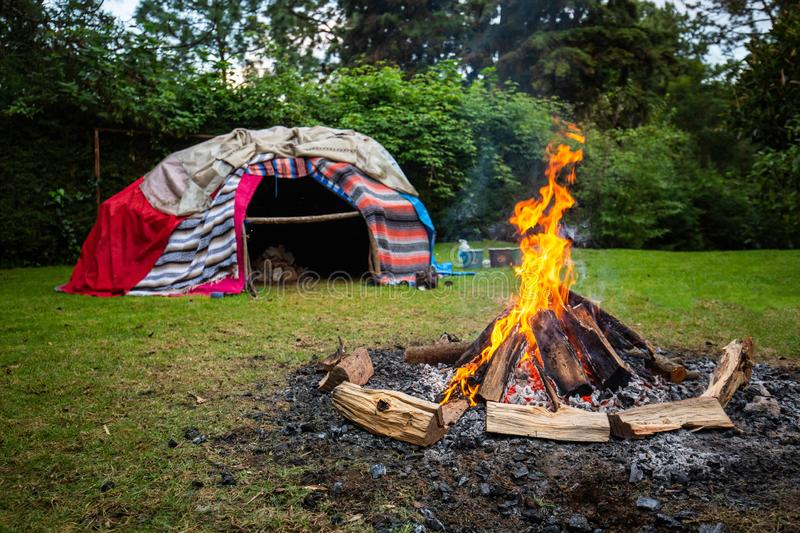 Traditional native sweat lodge with hot stones. Inside royalty free stock photos