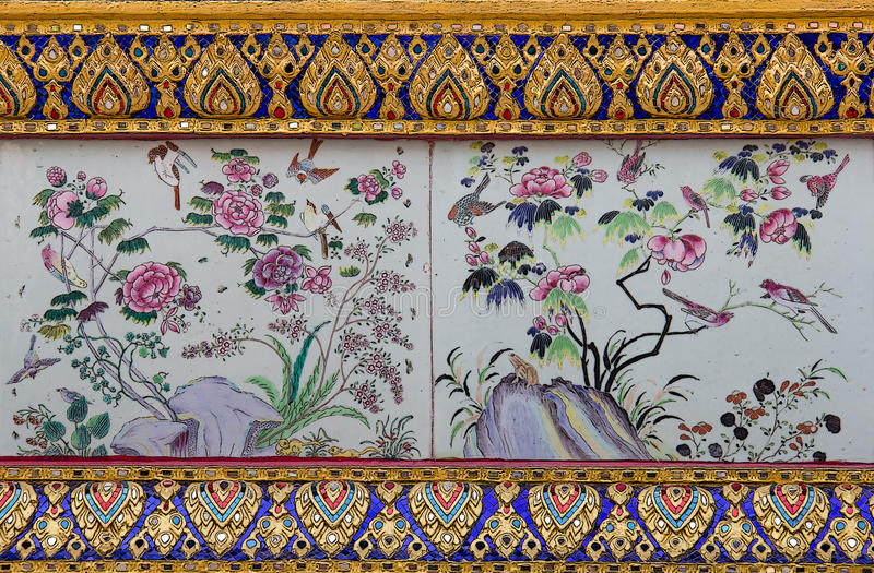 Traditional nature art of painting on Ancient wall of Thai temple stock photos