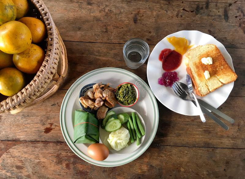 Traditional northern Thai style breakfast with oranges and bread on the wooden table stock photos