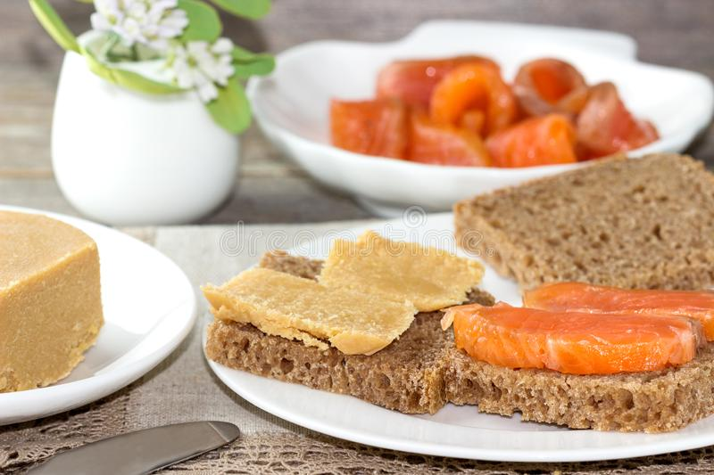 Traditional Norwegian breakfast, sandwiches with brown cheese brunost, sandwiches with cucumber and trout royalty free stock photo