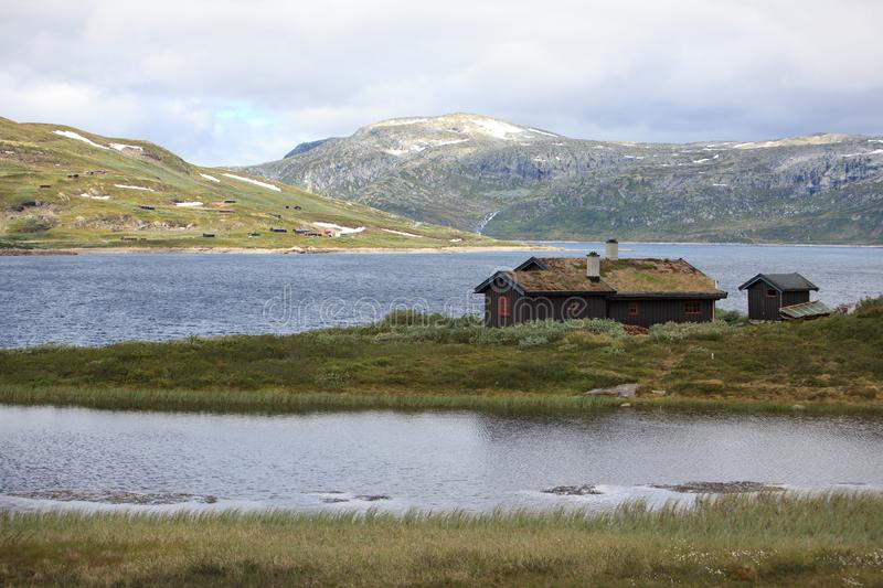 Traditional norwegian house in rugged landscape