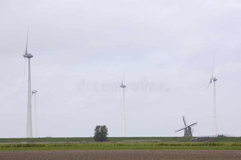 Traditional old dutch windmill goliath and wind turbines near eemshaven in the northern province groningen of the netherlands stock photos