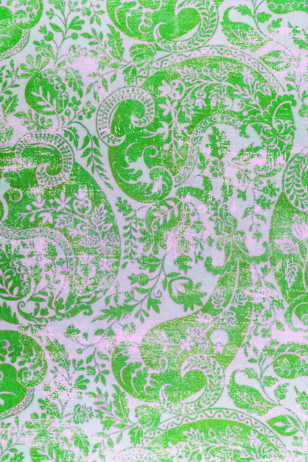 Traditional old fashioned shabby paper pattern. A closeup of an old fashioned shabby repeating paisley patter printed on paper background stock photography
