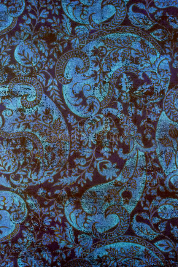 Traditional old fashioned shabby paper pattern. A closeup of an old fashioned shabby repeating paisley patter printed on paper background royalty free stock images