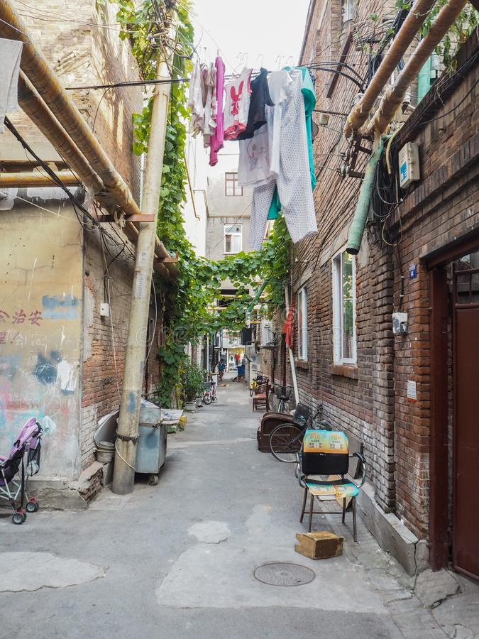 Traditional old neighborhood in Tianjin French concession. Tianjin, China - September 2017: Traditional neighborhood with old houses in the french concession in royalty free stock image