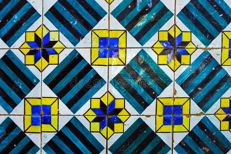 Traditional old portuguese porcelain ceramic tile azulejo. Traditional old porcelain ceramic tile azulejo on the facade of the house  #59 rue das Taipas in stock images