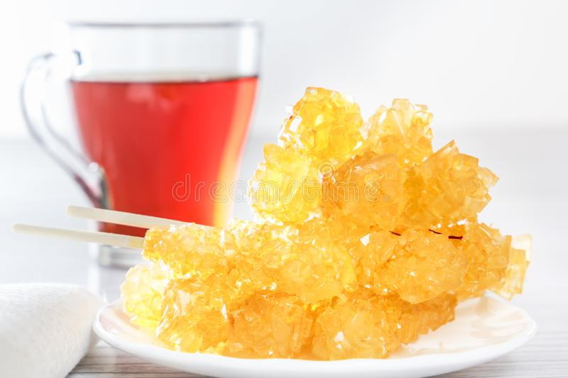 Traditional oriental sweets nabat - crystallized sugar with tea. Middle Eastern and Asian dessert stock photo
