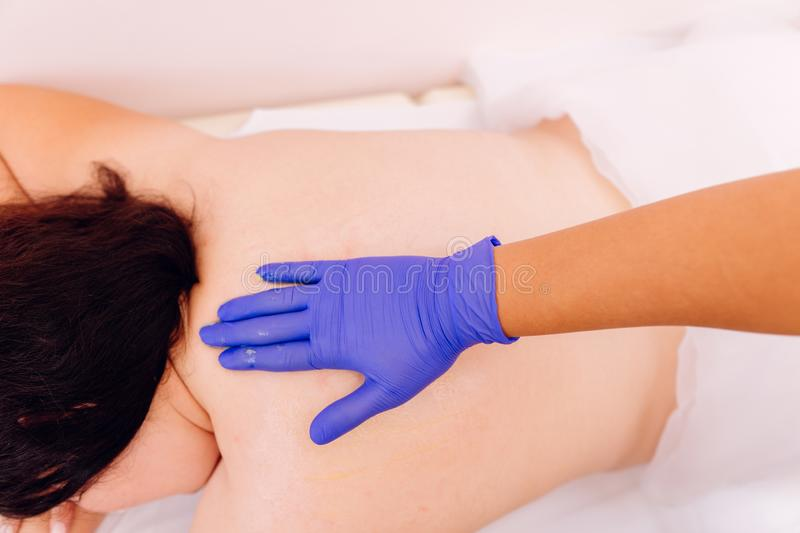 Therapist performing massage on young woman stock image