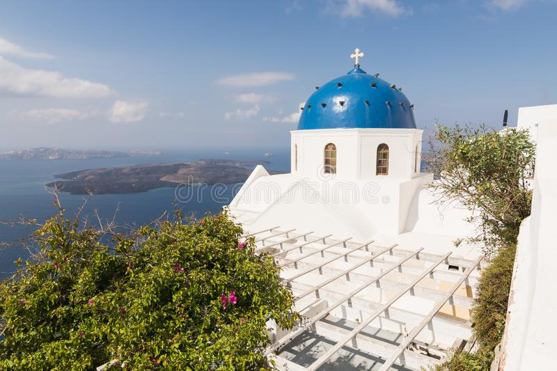 Traditional Orthodox blue dome church in Greece on a sunny summer day, with the typical blue and white colours. Santorini, Cyclade royalty free stock images