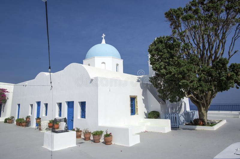 Traditional Orthodox blue dome church in Greece on a sunny summer day, with the typical blue and white colours. Santorini, royalty free stock photos