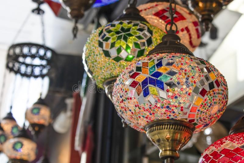 Traditional ottoman lamps closeup. A lot of mosaic glass royalty free stock images