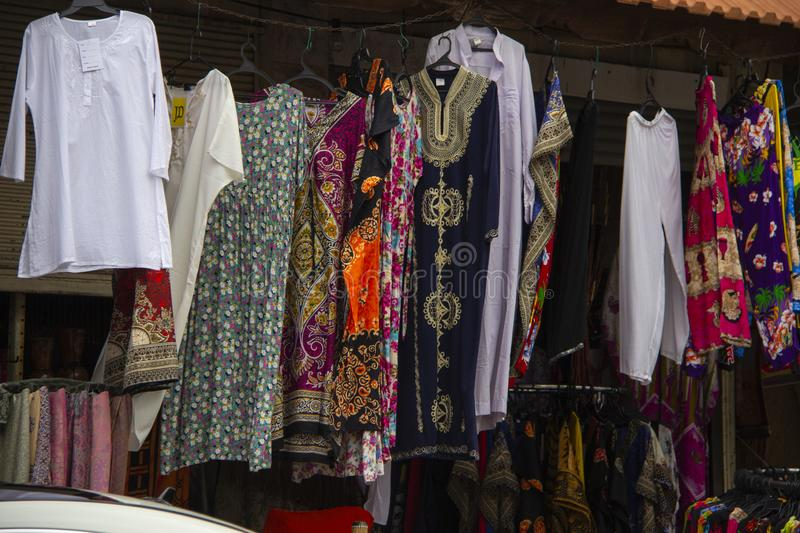 Traditional Outfits, Dresses hanging in an outdoor shop. Dresses, traditional outfits and blouses hang from a wire in a shop in the Druze village of Daliat el royalty free stock images