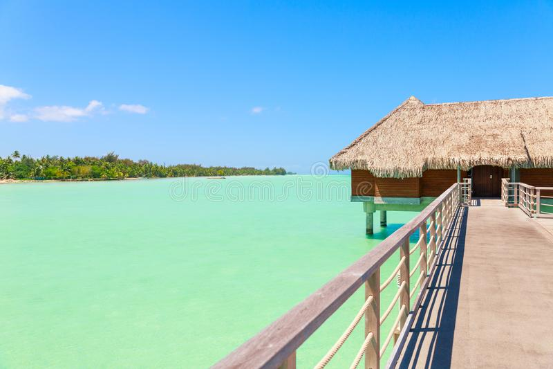 Traditional over water villa on a tropical lagoon of Bora Bora I stock photos