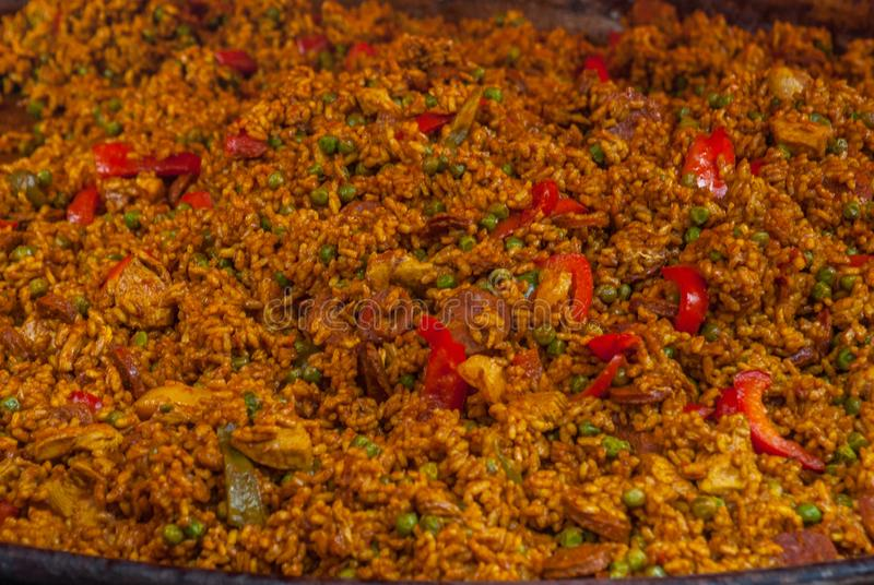 Traditional paella with chicken, sausage chorizo and vegetables served in paellera royalty free stock photos
