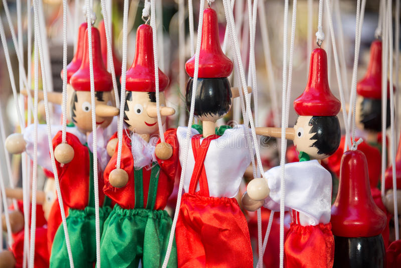 Traditional painted red and green wooden Pinocchio marionette dolls Italy royalty free stock image