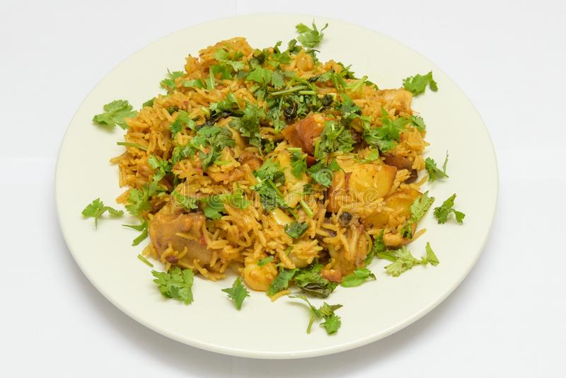 Traditional Pakistani Chicken Biryani Isolated on White Background. Delicious Pakistani Chicken Biryani with Coriander leaves Isolated on White Background royalty free stock photos