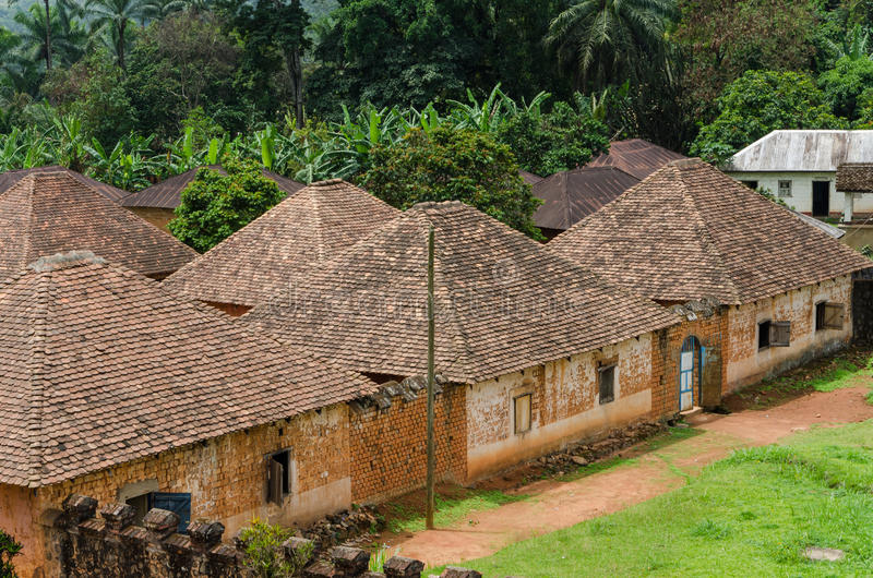 Traditional palace of the Fon of Bafut with brick and tile buildings and jungle environment, Cameroon, Africa royalty free stock photo