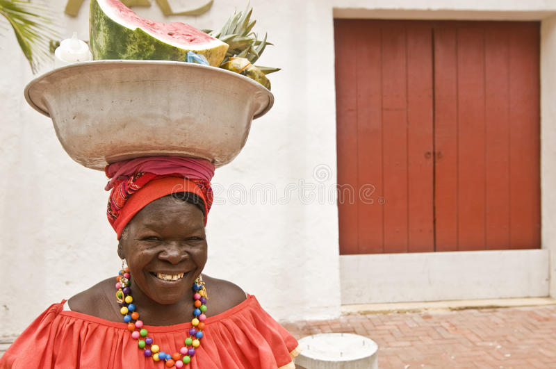 Traditional Palenquera Woman. Palenquera woman sells fruit on July 30, 2010 in Cartagena, Colombia. Palenqueras are a unique African descendant ethnic group stock image