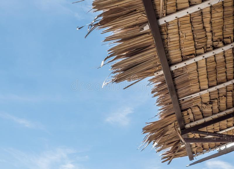 Traditional palm roof under the clear blue sky. royalty free stock photo