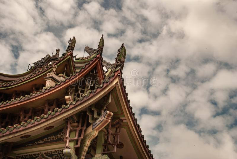Traditional patterns of the ancient Chinese Temple roof at Wat Bhoman Khunaram Bhoman Khunaram Temple. Bangkok, Thailand - 18 Aug 2019 : Traditional patterns of royalty free stock photo