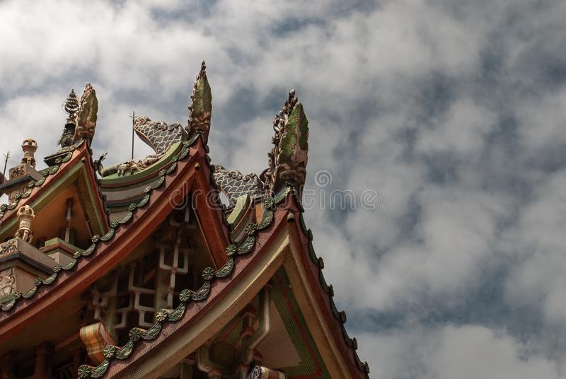 Traditional patterns of the ancient Chinese Temple roof at Wat Bhoman Khunaram Bhoman Khunaram Temple. Bangkok, Thailand - 18 Aug 2019 : Traditional patterns of stock photos
