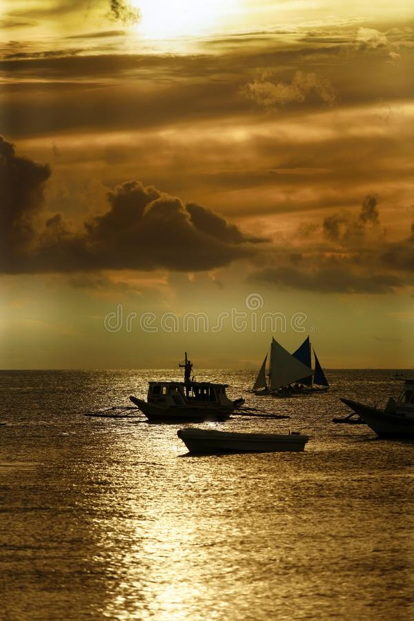 Traditional Philippine boats on sunset. Boracay royalty free stock images