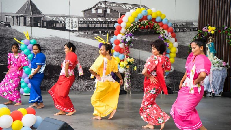 Traditional Philippine Dance. Beautiful women wearing traditional Philippine customes and dancing a traditional Philippine dance held during the Philippine stock photography