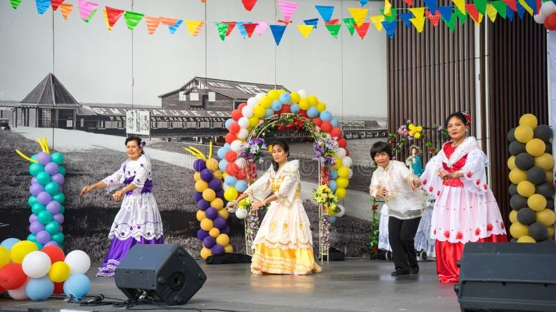 Traditional Philippine Dance. Beautiful women wearing traditional Philippine customes and dancing a traditional Philippine dance held during the Philippine royalty free stock photo
