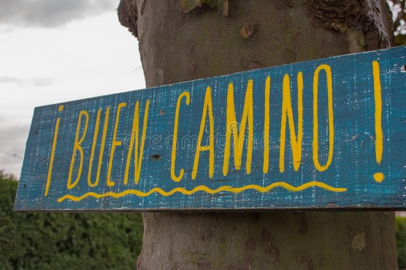 Traditional pilgrim`s sign on the Way of Saint James to Santiago de Compostela, Spain. Wooden vintage board `Buen Camino`. Traditional pilgrim`s sign on the Way stock photos