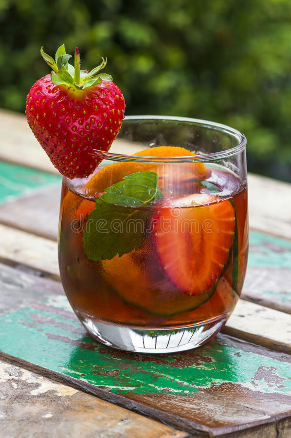 Traditional Pimms cocktail. With lemonade, strawberries, cucumber, orange and mint royalty free stock images