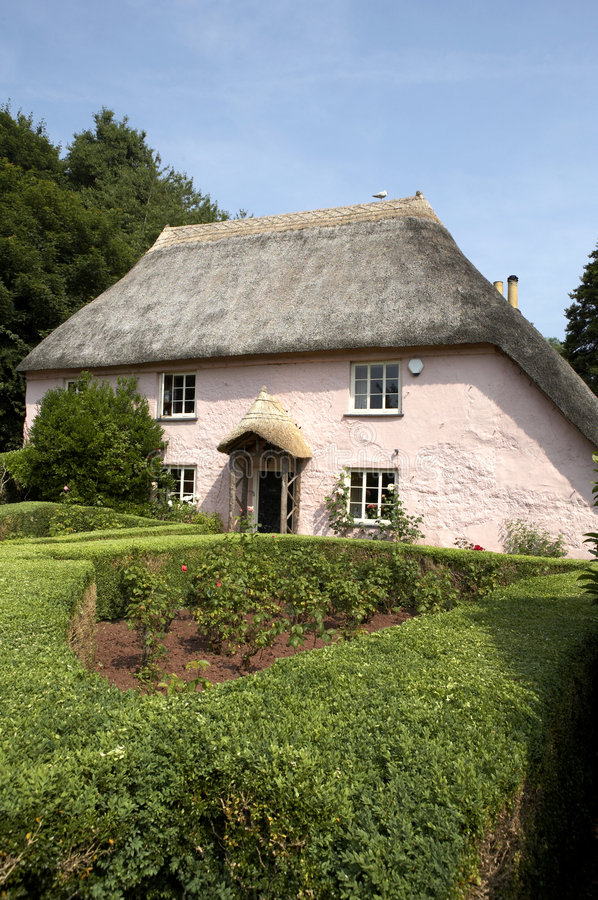 Traditional pink painted english cottage. In the small village of cockington torquay torbay devon england europe uk taken in july 2006 royalty free stock image